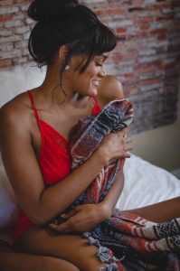Cozy boudoir photography in red